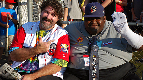 Rhashan (right) with pro wrestler Mick Foley at a game last season.