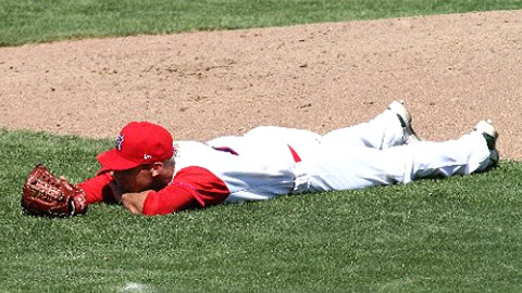 Blake Hassebrock lies prone as bees swarm above Stocton's Banner Island Ballpark.
